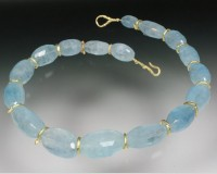 Faceted aquamarine necklace with 18K gold spacers & clasp...