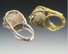 Twig ring with caged beachstone