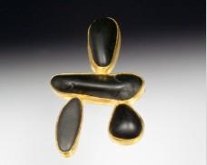 Four-stone basalt brooch