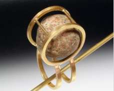 Caged beachstone ring