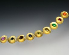 Disc bracelet with gemstones