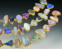 Bracelet with a suite of magnificent Australian boulder opals, each stone set in 22K bezels with 14K..
