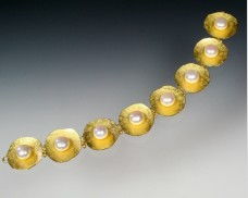 22K concave disc bracelet with pearls