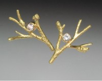 One of the smaller size twig branch earring. Various sizes are offered with a variety of diamond siz..