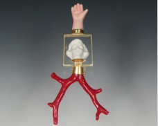 Girl, hand and coral pendant