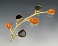 Crescent twig brooch