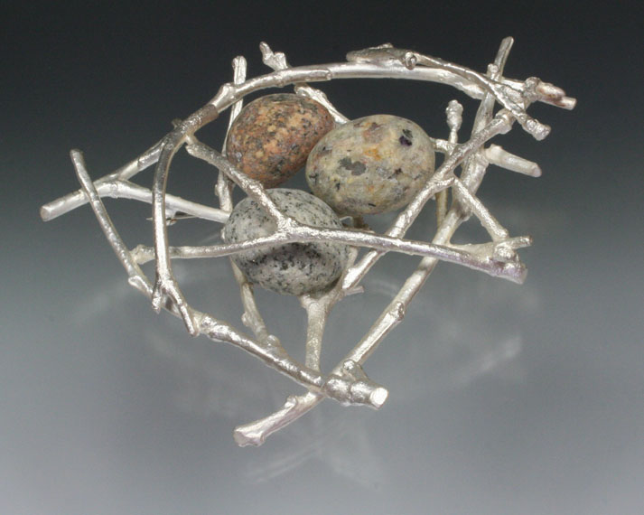 Twig nest brooch with beachstones